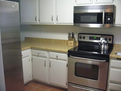 Stainless steel appliances, fully-stocked kitchen