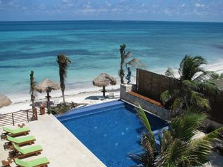 Puerto Morelos condo photo - View of the Pool, Courtyard and Beach