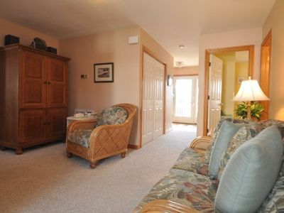 Mid-Level Den w/TV, DVD, Stereo.  Access to deck w/hot tub and stairs to pool.