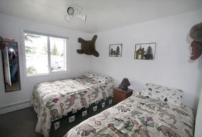 One of the three bedrooms.  This room has a double bed and a twin bed.