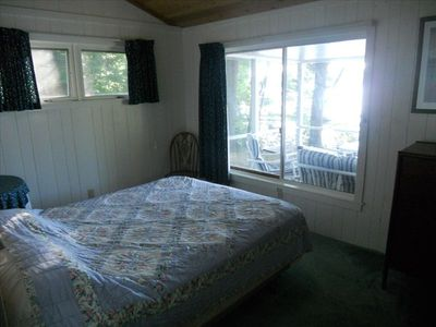 Bedroom in main house with queen bed plus view of lake.