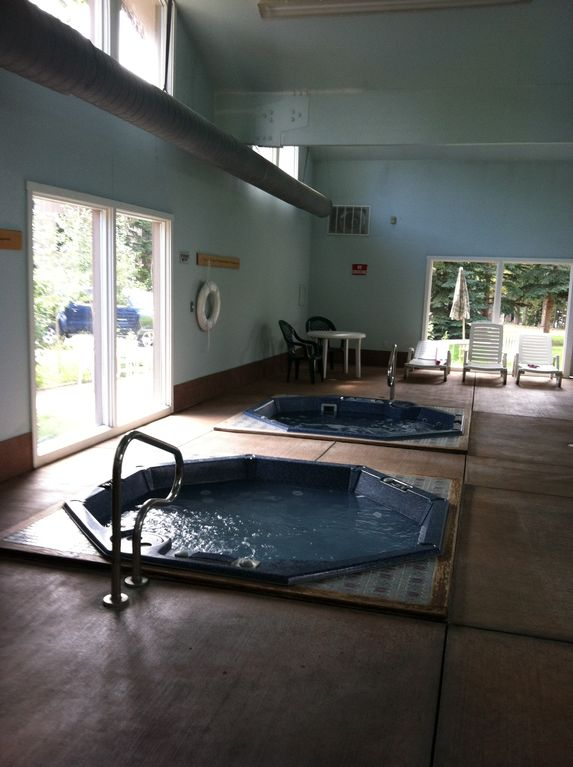 Separate clubhouse has two hot tubs and a pool with shower.