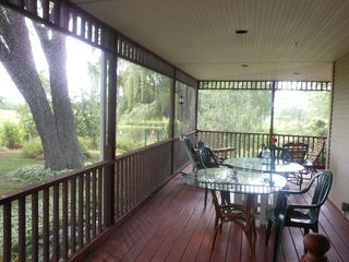 Lake Sinissippi cottage photo - Dining on south end of screened wraparound porch