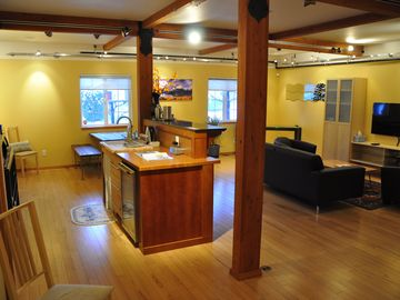 Main room with bar/living. Art gallery style lighting. Beech hardwood floors.