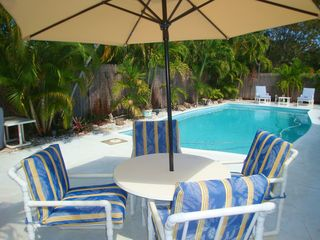 Fort Lauderdale house photo - The poolside table is perfect for that break from your dip in the heated pool.