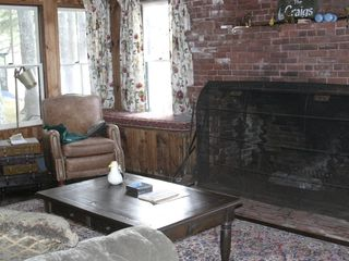 Acton lodge photo - Living room with huge fireplace.