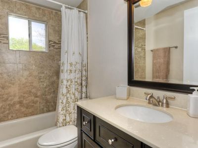 Austin house rental - Upstairs bathroom-completely remodeled in 2011 with custom tile floors & shower.