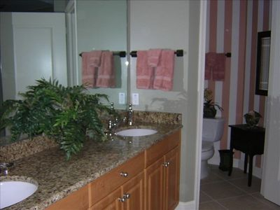 Master Bath with granite countertops, two vanities