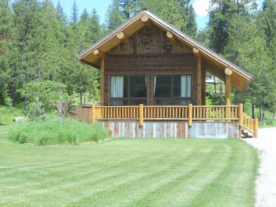 Homey Coram Cabin basking in the Montana sunshine, you will feel right at home.