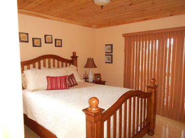 Second bedroom with private covered porch.