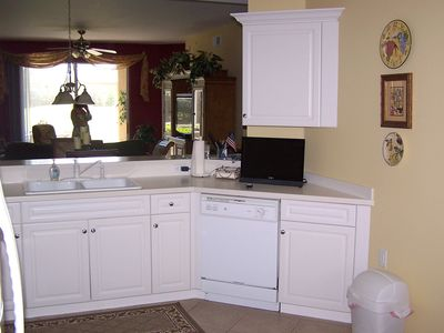 Kitchen with convenient counter flat screen TV.