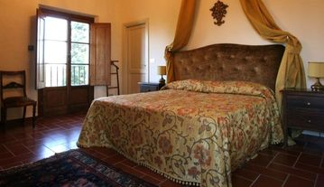 The bedroom in the tower of the villa