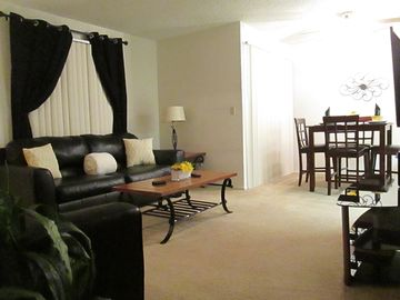 """Bakersfield apartment rental - Living room and dining area w/40"""" LCD tv and queen sleeper sofa"""