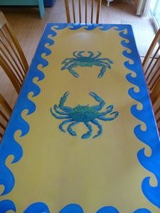 Enjoy dining at this whimsical, painted table. Seats 6 - 8.