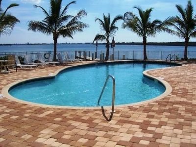 Madeira Beach condo rental - Beautiful pool overlooking Boca Ciega Bay - plenty of seating available.