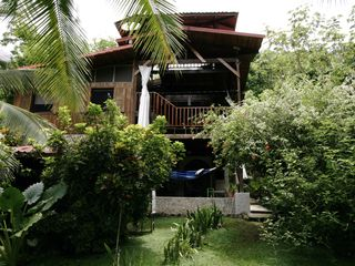 Montezuma villa photo - Relax on the hammock or stroll through the colorful tropical foliage.