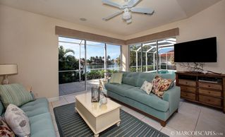 "Vacation Homes in Marco Island house photo - 46"" HDTV with Pool and Waterfront Views ..."