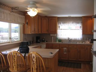 Laconia house photo - Kitchen w/ views to water and attached dining table