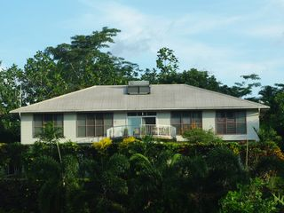 Samoa Islands house photo - Main House. The 2nd floor of the split level is below top of foreground shrubs.