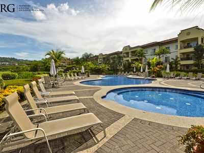 Pool Area - Pool Area with Sun Chairs and BBQ at Del Mar Condominiums. Enjoy incredible Sunsets from the pool area.