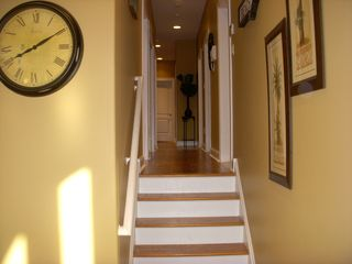 Gold Coast condo photo - Stairs leading to 2nd level & hallway to 5 bedrooms, 3 bathrooms, & laundry room