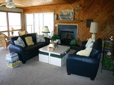 "Ocean-front Great Room: watch dolphins or 52"" TV, have tea by the fire."
