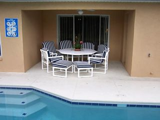 Sandy Ridge house photo - Comfortable patio furniture around pool