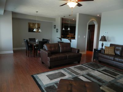 Direct Lakefront Living and Dining Room. Leather Furniture and Formal Dining Set