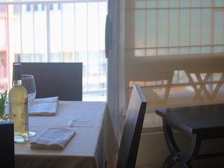 Isla Verde apartment photo - A nice place for dinner, sea on the background.