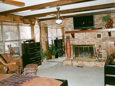 Extra large masterbed room, with fireplace. Large windows overlooking deck.
