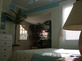 Queen bed with trundle bed in alcove - Tybee Island cottage vacation rental photo
