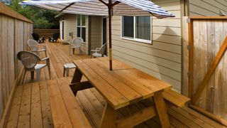 Lincoln City house photo - Large Wood Deck with Picnic Table & Gas BBQ.