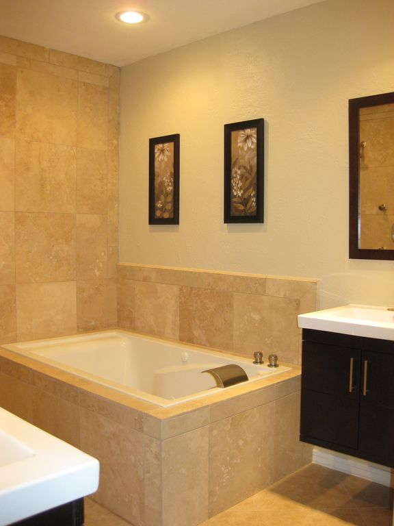 Master Bathroom with jetted tub, travertine shower w/body sprays