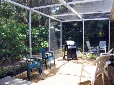 Grill & relax within the screened enclosure, access from dining & master bedroom