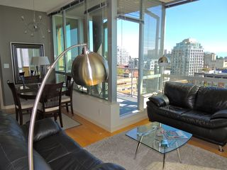 Victoria condo photo - Living and dining areas with city views.