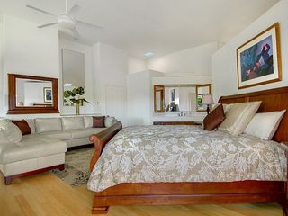 Poipu house photo - First master suite features king bed private lanai, AC