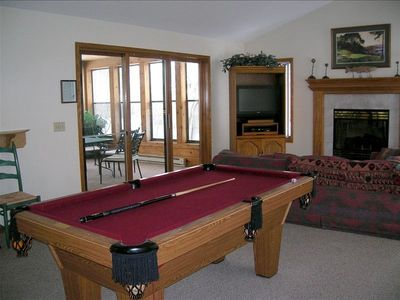 Pool Table on main level in it's own entertainment room
