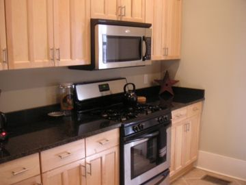 Kitchen features granite countertops and stainless steel appliances