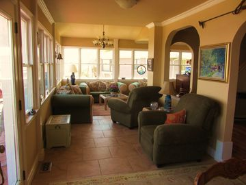 Sun room off of Kitchen and Living room, wall to wall glass,breathtaking views