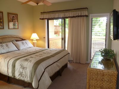 Poipu condo rental - Master bedroom with king bed and sliding door to lanai and flatscreen TV