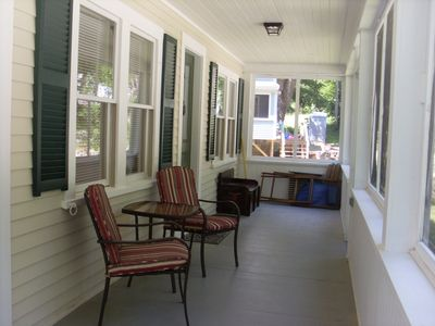 Wrap-around porch. Chest holds beach toys and yard games like croquet.