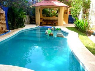 Beautiful private pool has waterfalls, swim-up bar, and separate kiddie area. - Playa del Carmen villa vacation rental photo