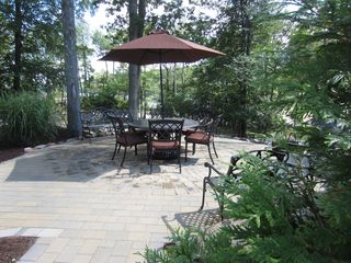 Big Boulder house photo - Circular stone patio