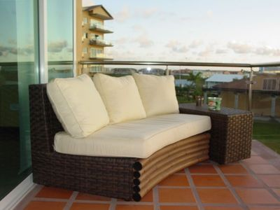 Comfortable lounging furniture on your balcony terrace with ocean view....