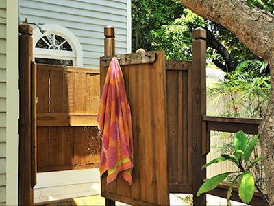 Outdoor shower off large deck near swimming pool