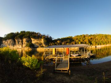 Beaver Lake house rental - Private boat dock with 2 boat slips, 3 kayaks, life preservers & paddles.