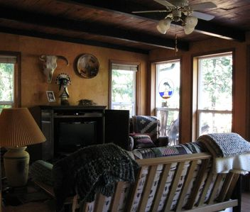 Crescent City cabin rental - Cozy-up on the futon & watch a DVD