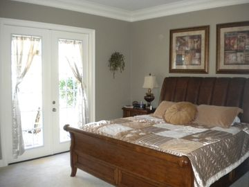 Master Bed & Bath, with Luxury King Bed, Jacuzzi Tub and access to rear patio