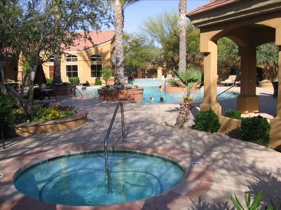 Outdoor Entertianment Includes Pool with Fountain, Jacuzzi, and Fireplace.
