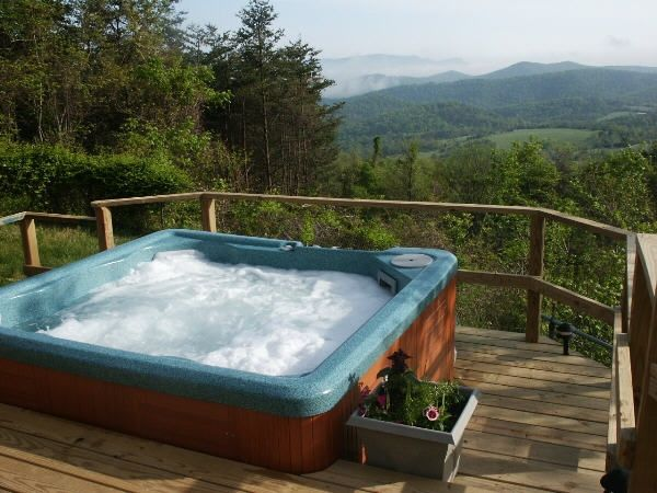 Summer Time at The Cabin Hot Tub with a waterfall Feature